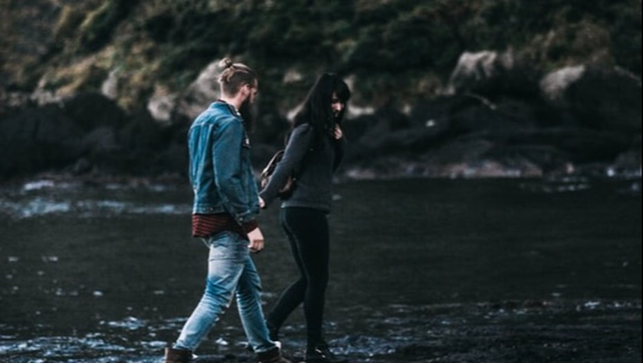 Couple Walking Together by a River